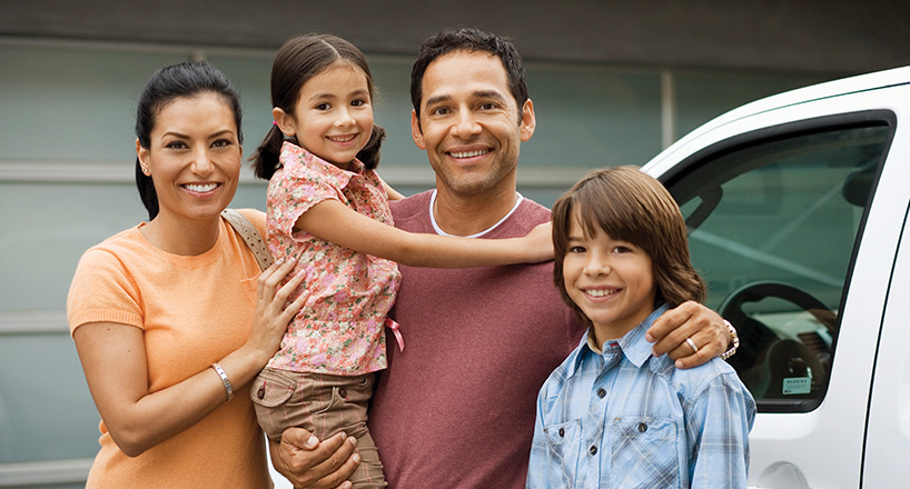 Photo of a family with their new car purchased with a Mission Fed Auto Loan.