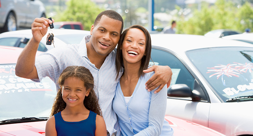 Photo of a happy family with auto loans