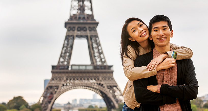 Photo of a couple enjoying their Mission Rewards in Paris