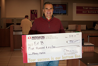 Photo of Ed B. holding his Money Match check