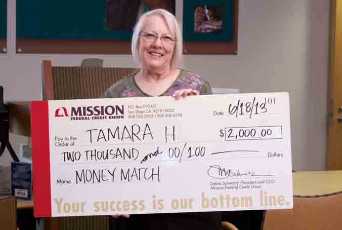 Photo of Tamara H. holding her Money Match check
