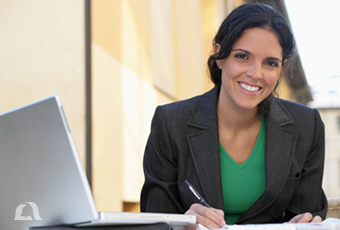 Photo of smiling woman working on her laptop.