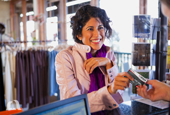 Photo of woman shopping with Platinum credit card