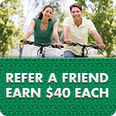 People riding a bicycle in refer a friend ad