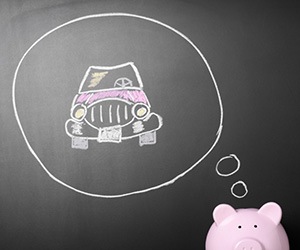 Photo of a piggy bank dreaming of the money it has saved to buy a car.