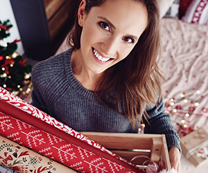 Photo of a woman ready to wrap holiday presents.