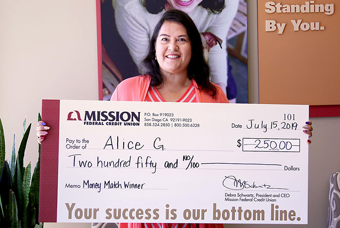 Alice G. with giant check