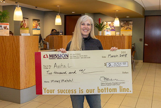 Anita L with giant check