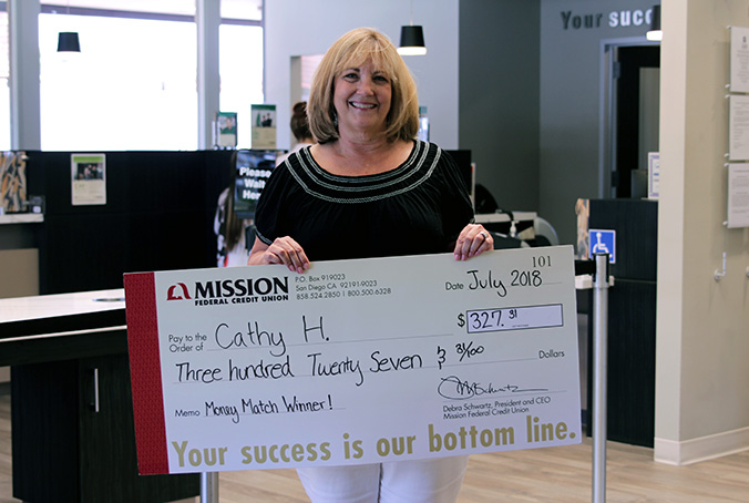 Cathy H with giant check