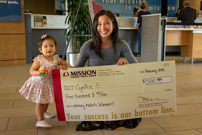 Cynthia F and her sweet daughter with giant check