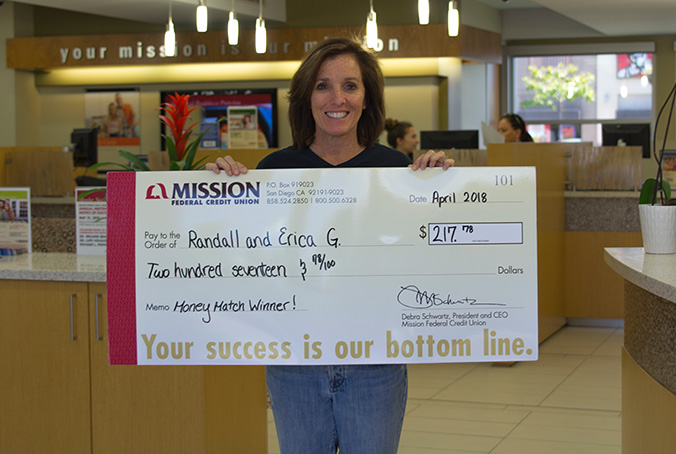Erica G with giant check