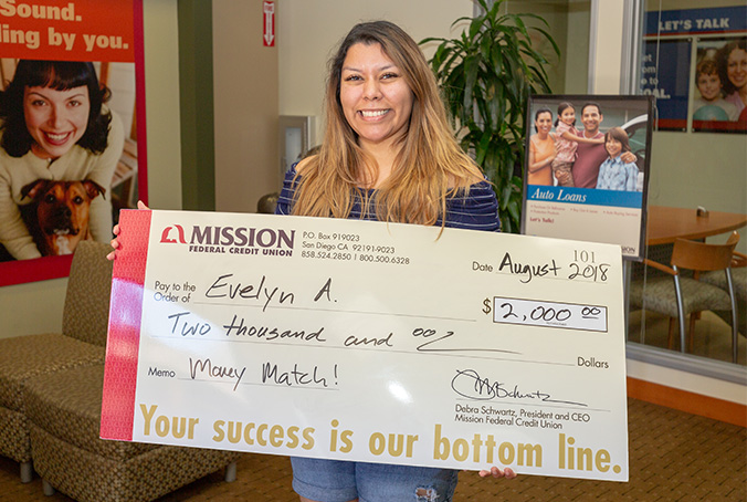 Kristin S with giant check