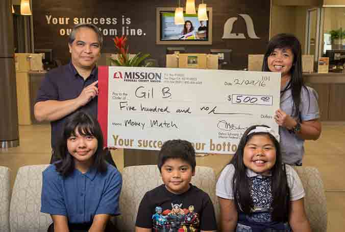 Gil B. and his family with giant check