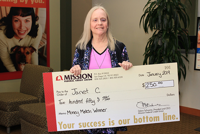 Janet C with giant check