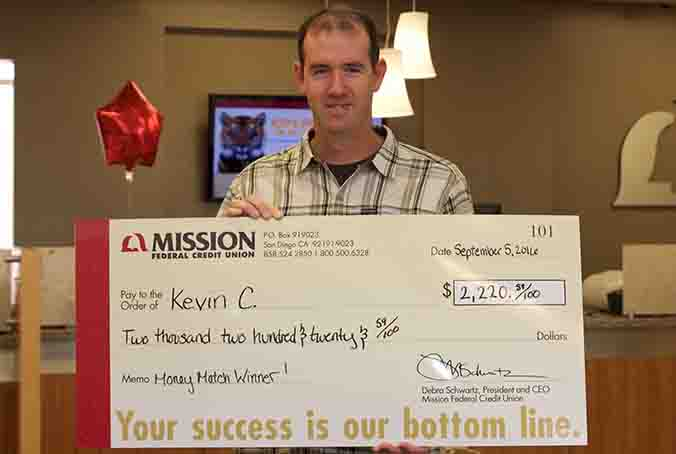Kevin C. with giant check