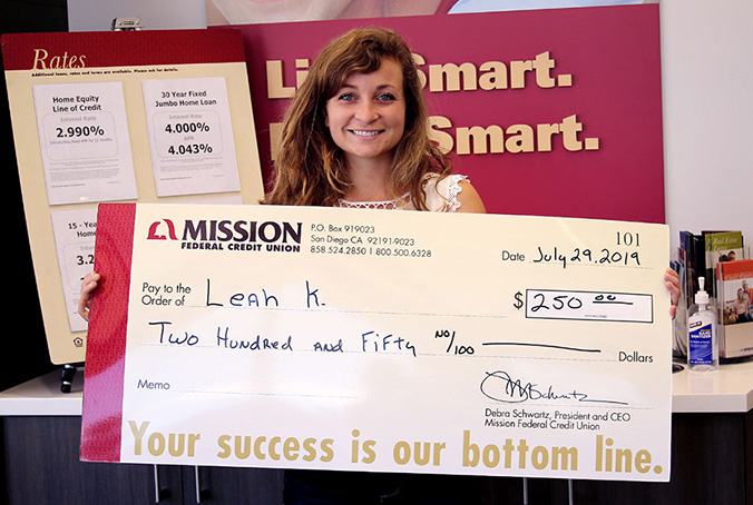 Leah K. with giant check