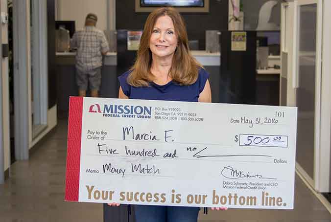 Marcia F. with giant check