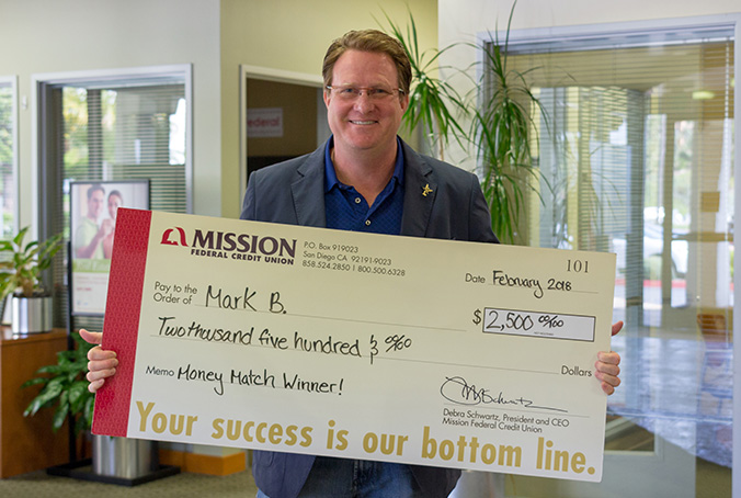 Mark B with giant check