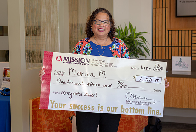 Monica M with giant check