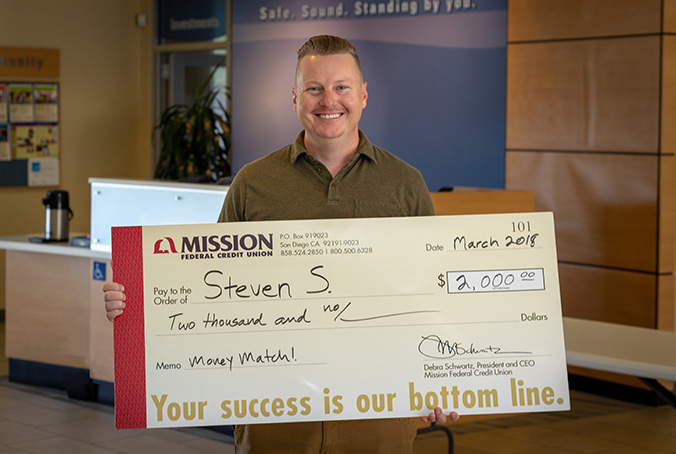 Steven S with giant check