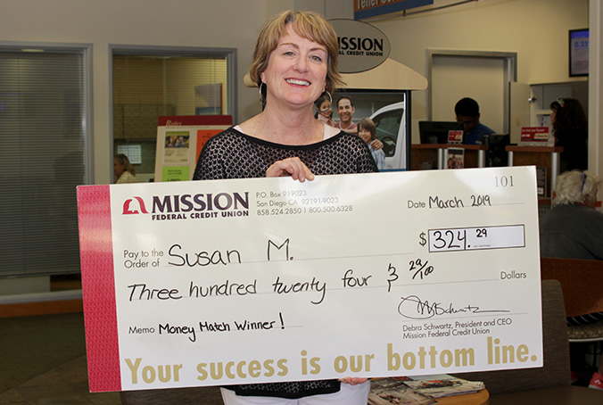 Susan M. with giant check
