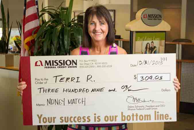 Terri R. with giant check