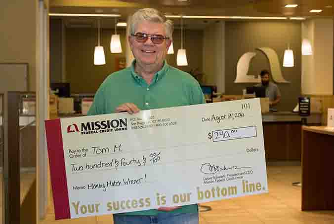 Tom M. with giant check