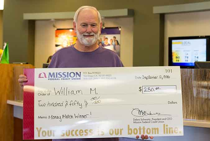 William M. with giant check