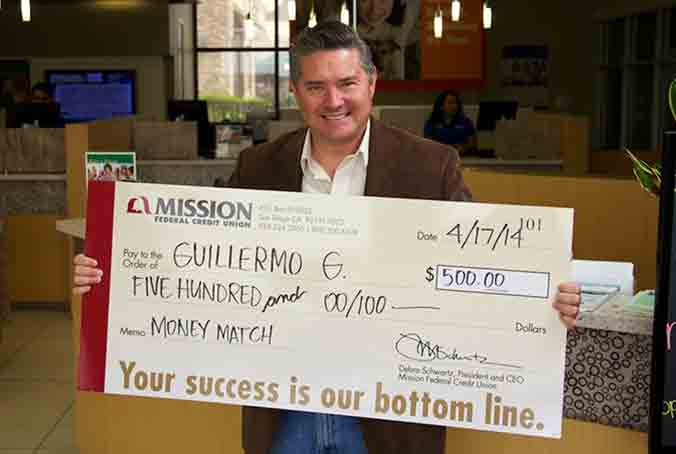 photo of Guillermo G. with giant check