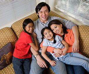 Happy family who have attended Mission Fed' First-Time Homebuyer Seminars and Long-Term Care Workshops.