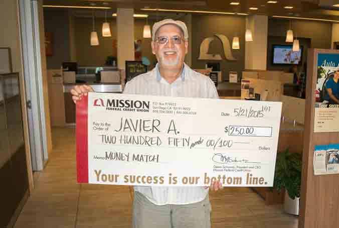 Javier A with giant check