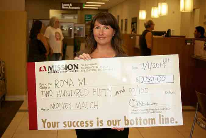 Roya M. with giant check