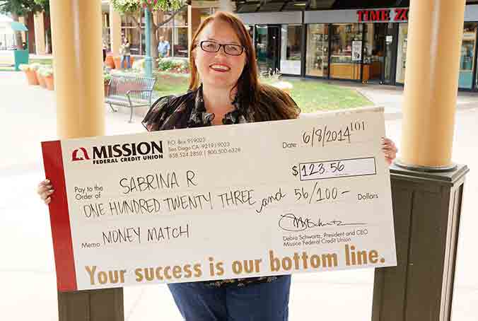 Photo of Sabrina R. with giant check
