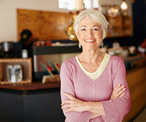 Photo of a smiling woman at a café.