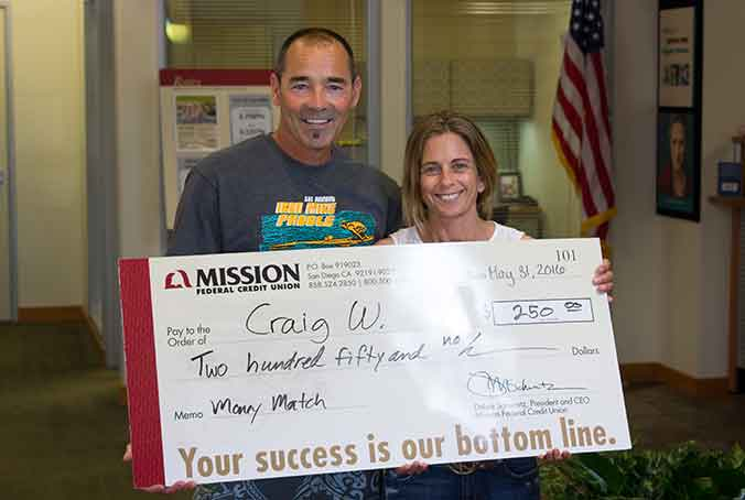 Craig W. with giant check