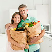 Photo of happy couple in their kitchen.