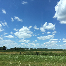 Photo of blue sky and grassy field in Ohio.