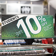 Photo of a sign in a clothing store offering students a 10% discount.