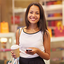 photo of a woman out shopping with google pay on her phone