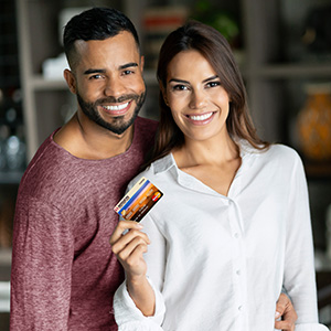Photo of a couple who use Mission Fed credit cards to help save money and manage their financies.