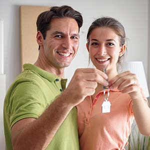 Photo of a happy couple in their new home purchased with a Mission Fed Home Loan.