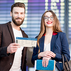 Photo of a happy couple using their Mission Rewards on airline tickets for their vacation.
