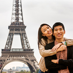 Photo of a couple enjoying their Mission Rewards in Paris.