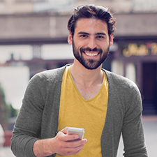Confident man using Mission Fed's Mobile Banking app.