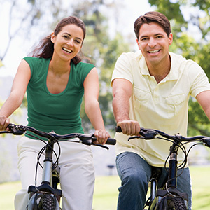 Photo of couple enjoying a ride on their bicycles.