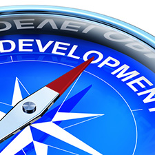 image of a compass pointing to the word development