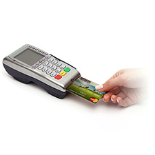 photo of a point of sale machine and a chip card in action