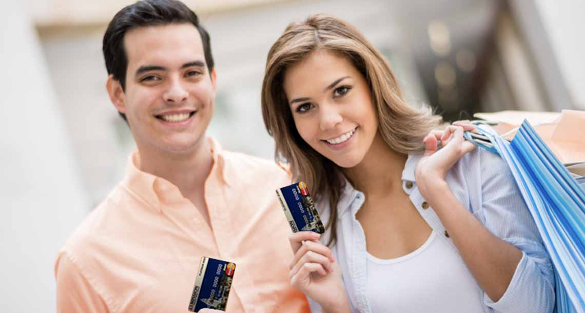 Happy couple shopping with a Mission Fed Platinum Debit Card.