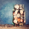 photo of a glass jar full of coins