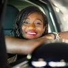 Photo of a happy woman who purchased her car with a Mission Fed auto loan.